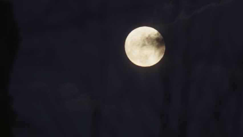 CLOSE UP: Dark clouds covering a full moon | Shutterstock HD Video #9313226