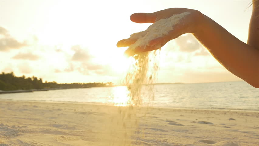 SLOW MOTION: Female playing with white sand on exotic beach