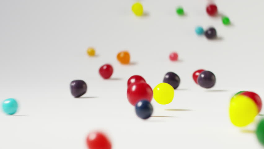 Slow motion close up shot of rolling jellybeans: Cedar Hills, Utah, United States