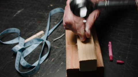 THE WRONG TOOL FOR THE JOB #4.  THE HANDS OF AN IDIOT TRIES TO HAMMER A NAIL, INTO TWO PIECES OF LUMBER, WITH A WRENCH.   OF COURSE IT FAILS, BUT IT IS ENTERTAINING NEVER THE LESS.  D.I.Y. HUMOR.