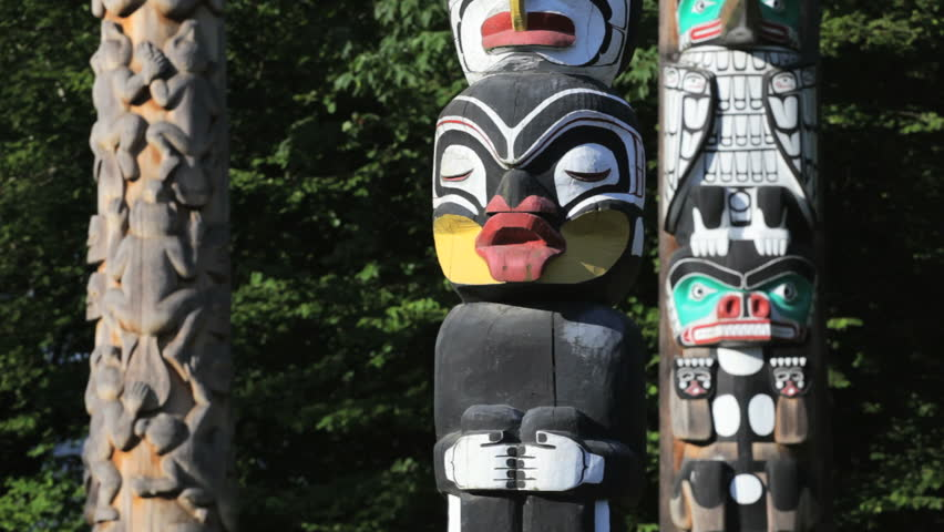 Vancouver, BC, Canada, downtown Stanley Park's collection of Native totem poles, dolly/ tracking shot