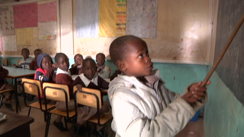 NAIROBI, KENYA - CIRCA JULY 2009: A young Kenyan schoolboy recites English phrases with his classmates. High definition.