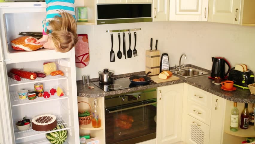 Fridge In Kitchen little girl upside down stands near fridge in kitchen in inverted