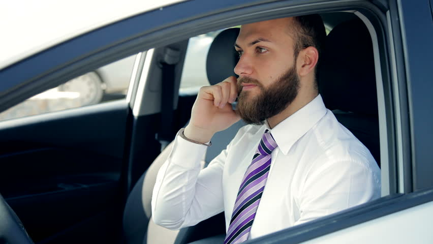 Cool Business Man Sitting In Car On The Phone Working With Tablet Stock  Footage Video 9460319 | Shutterstock