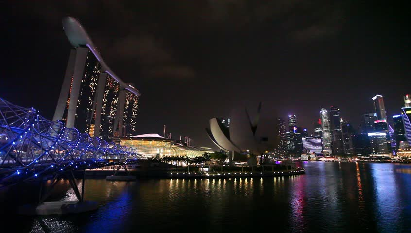 Singapore - MAR 20 : Nightscape of Singapore Marina Bay Sand and Helix Bridge on March 20,2015 in Singapore. Marina Bay Sands is billed as the world's most expensive casino property at S$8 billion. #9463379