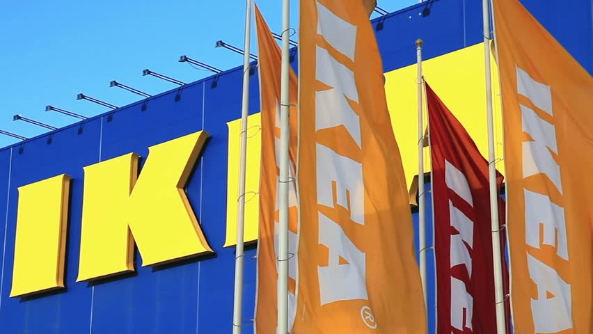 SAMARA, RUSSIA - SEPTEMBER 6, 2014: IKEA flags against sky at the IKEA Samara Store. IKEA is the world's largest furniture retailer. It was founded in Sweden in 1943