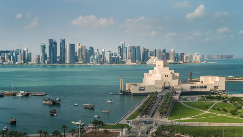 Doha, Qatar - CIRCA DECEMBER 2013: Wide-shot POV time-lapse view, Museum of Islamic Art and Dhow Harbor