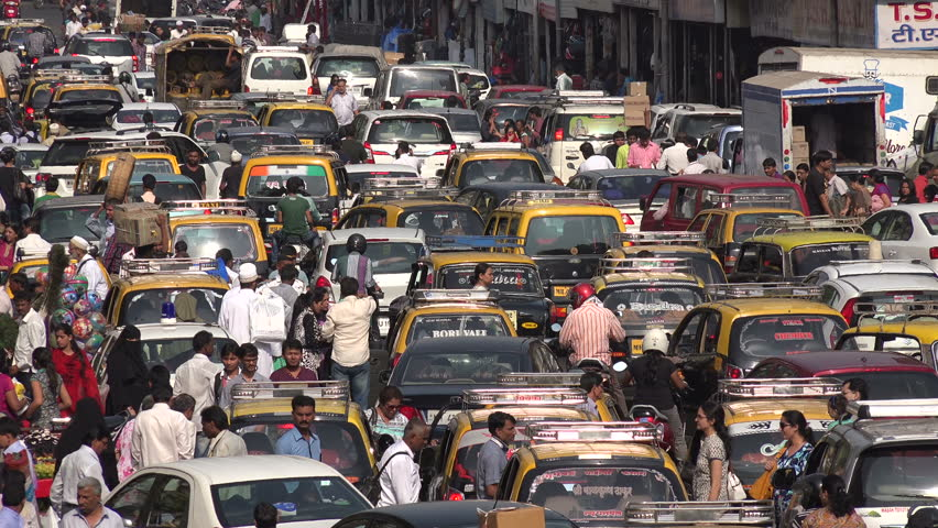 MUMBAI, INDIA - 8 NOVEMBER 2014: Major traffic jam in front of a busy bazaar in Mumbai. The streets are filled with cars, pedestrians, workers, and others.