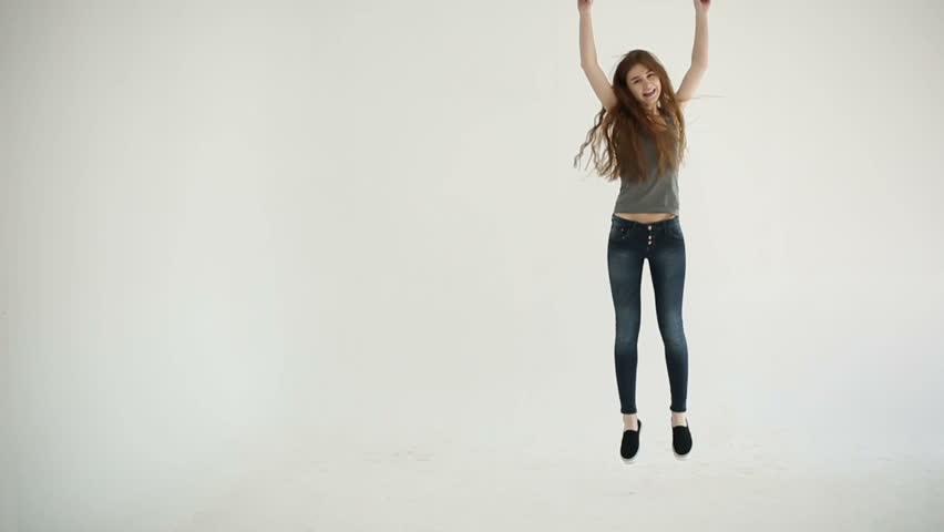 Attractive teenager girl cheering and joyful. Slow motion
