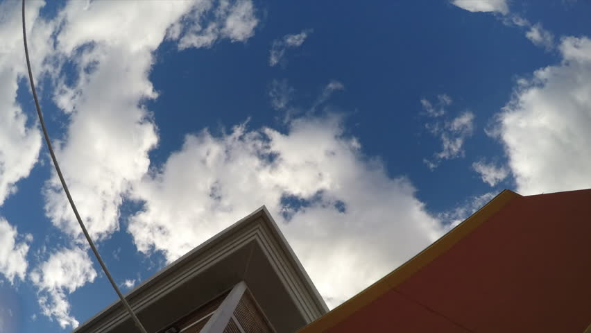 Time Lapse Clouds moving past building sharp edges | Shutterstock HD Video #9547319