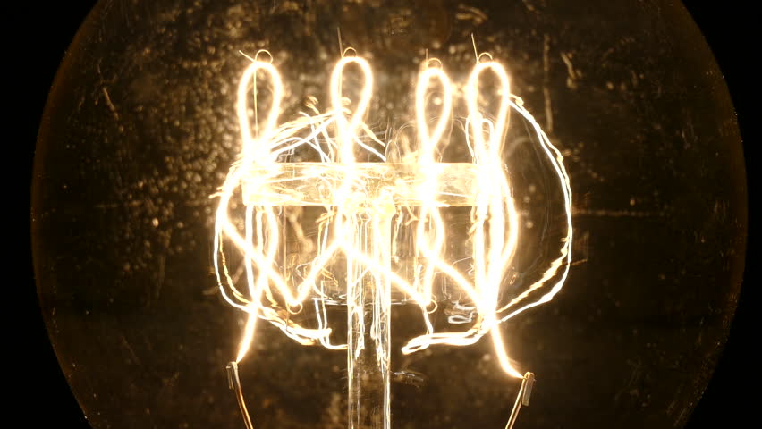 Zooming macro of glowing vintage incandescent light bulb filament   Shutterstock HD Video #9547979