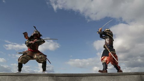 the duel of two Japanese samurai against the sky with clouds
