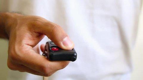 opening garage door. hand and remote controller