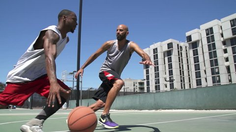 Two Basketball Players Playing One on One Outside with Scoring