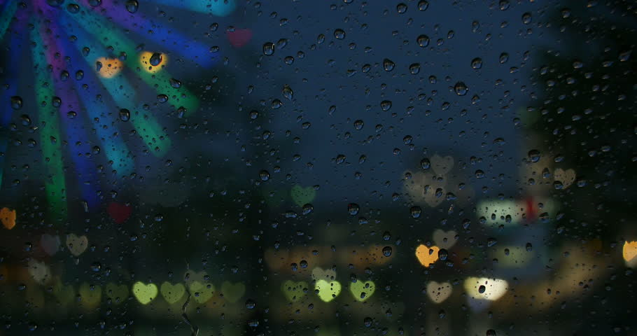 (Heart Image) Variation of dancing hearts performed by city illuminations focused on raindrops.   Shutterstock HD Video #9688769