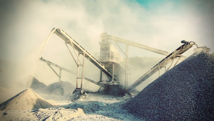 Stone crusher (rock stone crushing machine) at open pit mining and processing plant for crushed stone, sand and gravel. Vintage retro effect filtered hipster style video clip.