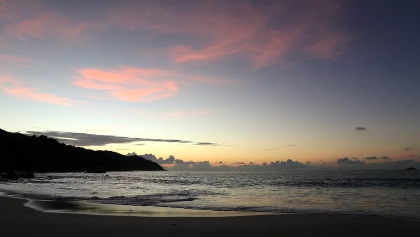 Beautiful sunset on the beach of Anse Lazio. Island of Praslin in Seychelles. -