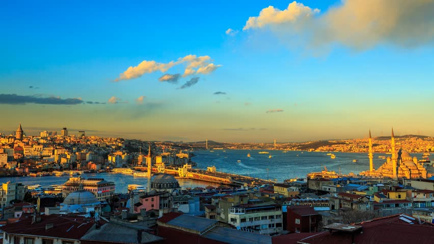 ISTANBUL - APRIL 02: Panoramic view over Istanbul during golden hour with view at the Galata Bridge, Yeni Mosque and Boat Traffic. Time Lapse in 4K. April 02, 2015 in Istanbul, Turkey.  | Shutterstock HD Video #9716387