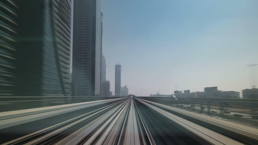 Dubai Metro. A view of the city from the subway car.  Dubai Metro as world's longest fully automated metro network 75 km, Dubai, UAE. Timelapse, hyperlapse, drivelapse | Shutterstock HD Video #9724829