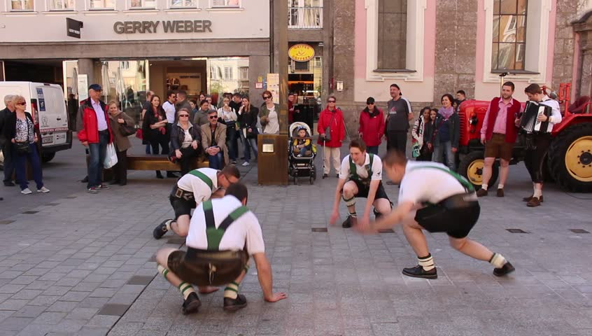 INNSBRUCK, AUSTRIA - APRIL 24: Men are dancing in traditional Austrian leather breeches (Lederhosen) for