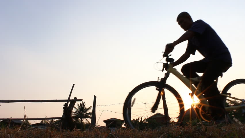 Silhouette of the man cycling bicycle  #9730199