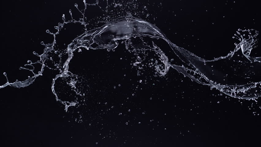Water splash in midair against black background. Shot with high speed camera, phantom flex 4K. Slow Motion. Unedited version is included at the end of clip.
