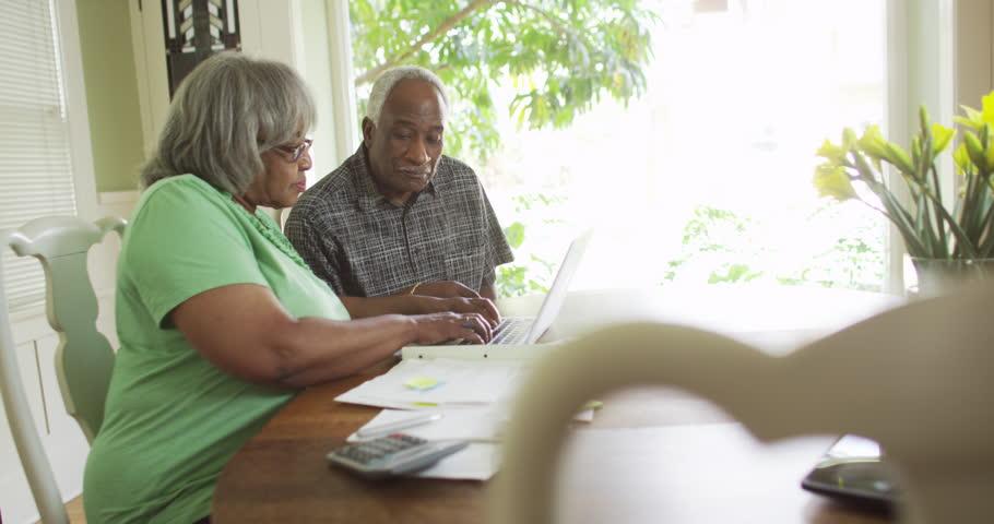 Senior black couple paying bills on laptop   Shutterstock HD Video #9778691