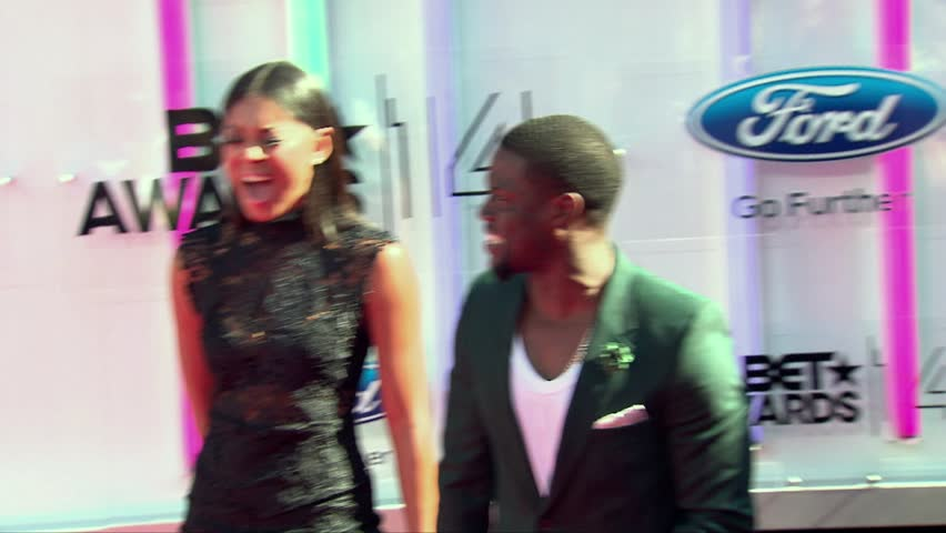 Los Angeles, CA - June 29,2014: Kevin Hart and Eniko Parrish at BET Awards 2014, Nokia Theatre   Shutterstock HD Video #9781079