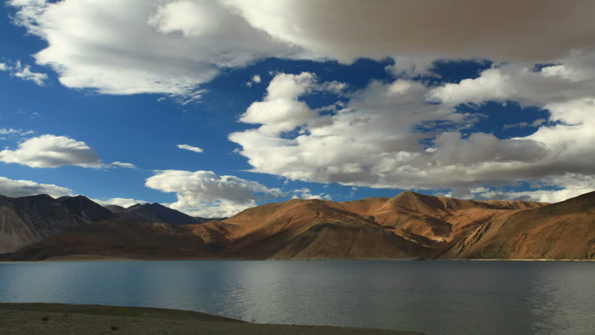 Time lapse. Incredibly beautiful flying sluds over mountain lake. Pangong Lake. Pangong Lake, is an endorheic lake in the Himalayas situated at a height of about 4,350 m. extends from India to Tibet. | Shutterstock HD Video #9793829