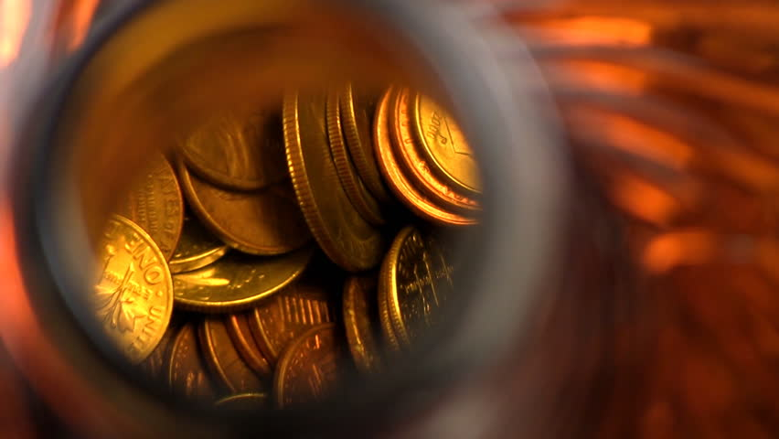 Close-up looking into top of glass jar as coins are dropped inside | Shutterstock HD Video #9802979