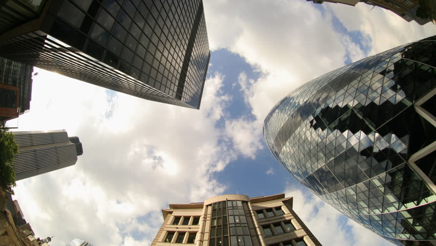 fisheye shot looking up to the sky catpuring the swiss RE building in london