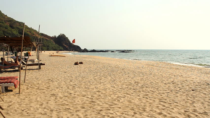 Goa, India – February 22, 2015: Unidentified people relaxing on the beach. Goa state Querim beach.