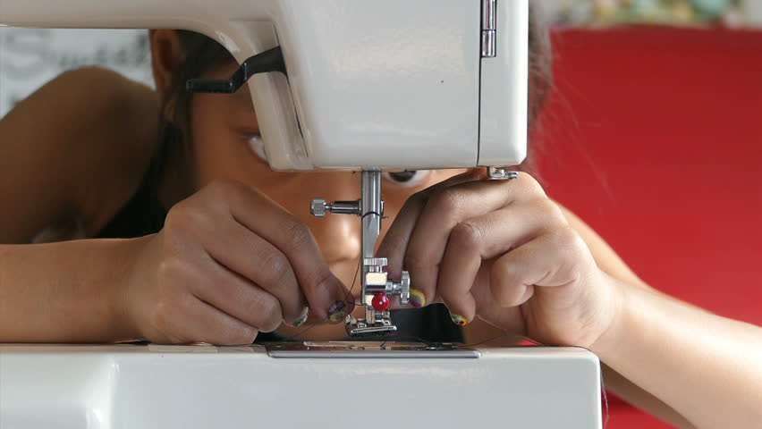 Cute Asian Girl Learning How Sew On Stock Video Footage 40K And HD Impressive Learning How To Sew With A Sewing Machine