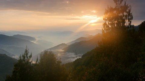 Foggy Himalayas mountains at sunset lights. Nepal, Langtang national park. UHD, 4K