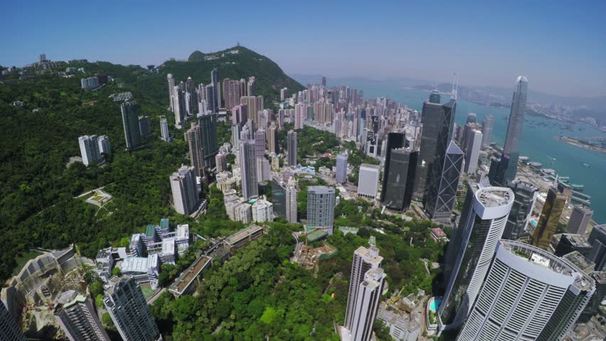City Aerial 4K Hong Kong Island 4K Aerial shot of general Hong Kong covering the premium residential area at mid level and the central business along the sides of the harbor.  | Shutterstock HD Video #9871256