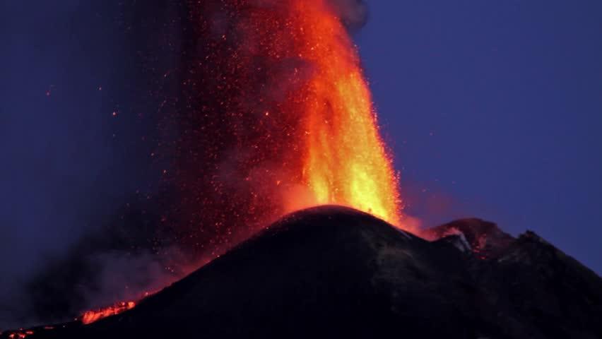 Volcano eruption at sunset. Mount Etna paroxysm of October 26, 2013
