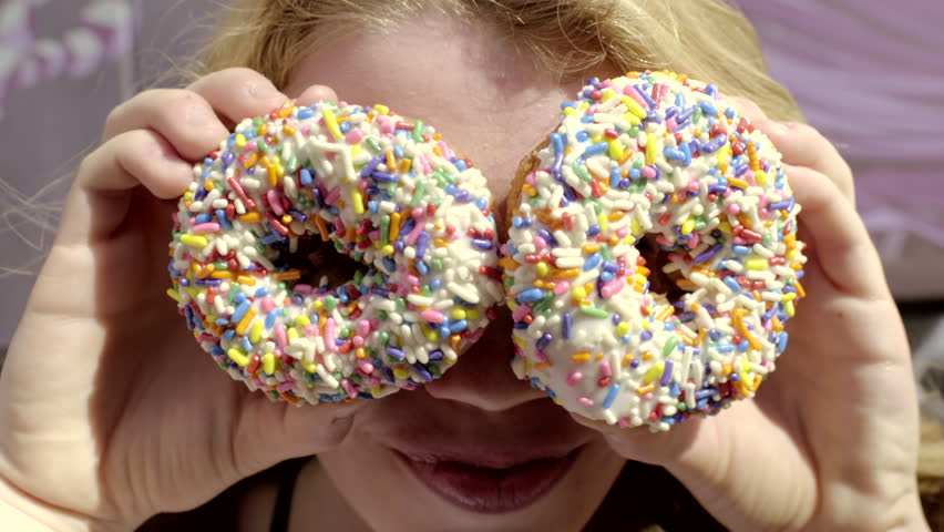Silly Teen Girl Pretends She Has Donuts For Eyes, She Smiles And Laughs (4K)