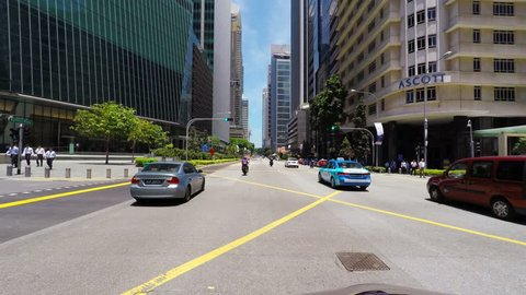 SINGAPORE - CIRCA APRIL 2015: POV, driving in business district Raffles Place.