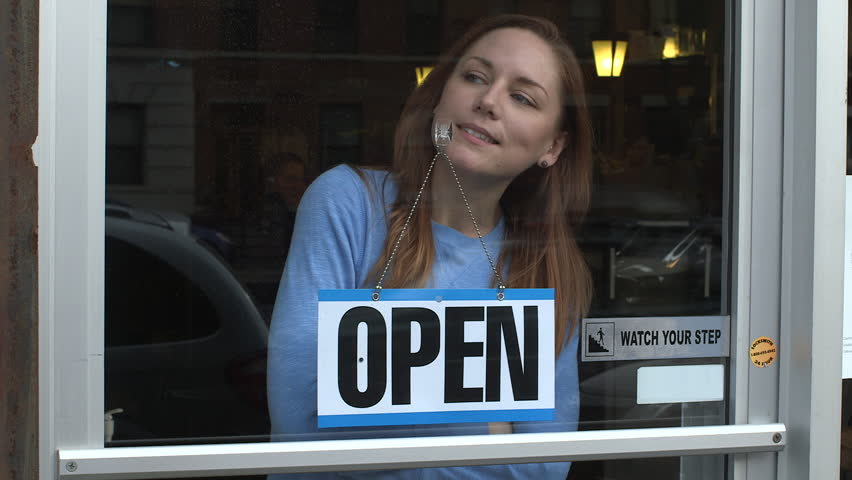 A young woman opens a store for business in New York City | Shutterstock HD Video #9932570