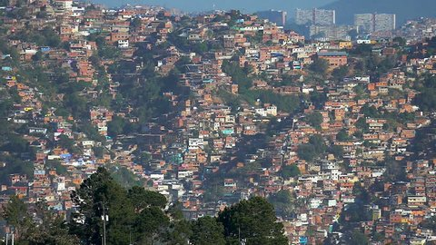 Panning view of a shanty town residential district in Caracas City, Venezuela. Poorness is a main factor for drug dealing and crime in these places and a common factor in developing counties.