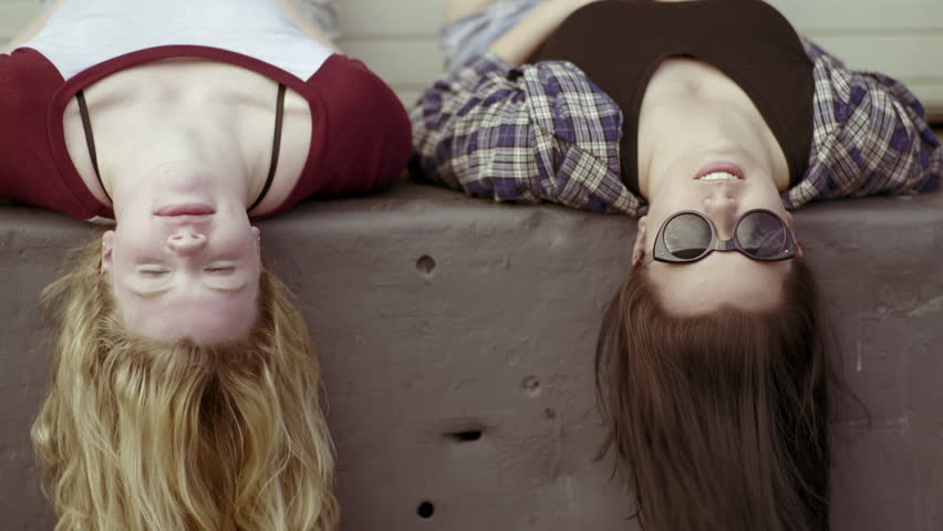 Chat stock footage video shutterstock best friends hang out on a loading dock they lay down and chat urmus Image collections