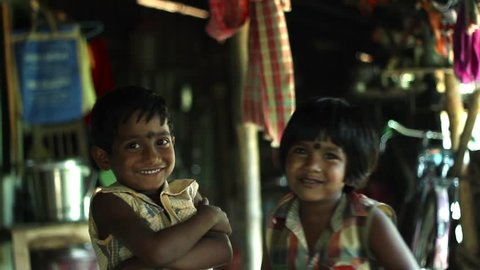 Two cute village kids posing and playing in India